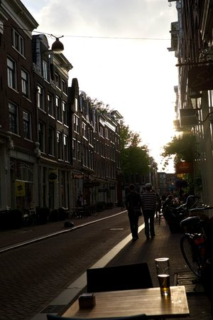 MAX Amsterdam: Outdoor seating area at sunset.