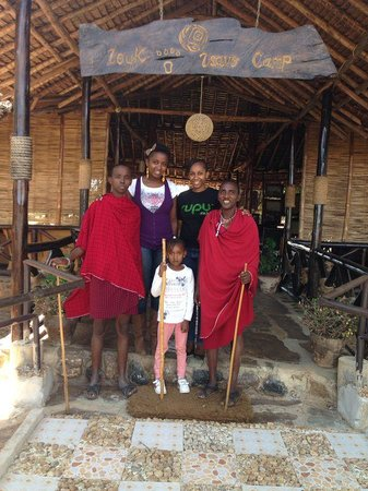 A photo of us and the Masaai's at the entrance of Loyk Tsavo Camp