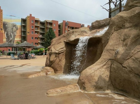 "Kalahari Resorts & Conventions: Kiddie waterfall(pool) with ""Sands"" section in background"