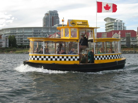 Victoria Hippo Tours : View of one of the many water taxis from our Hippo bus while on the water.