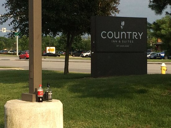 Country Inn & Suites by Radisson, Toledo, OH: Jack and Coke by the front entrance, late evening the day AFTER the campground chaos.  Keep it c