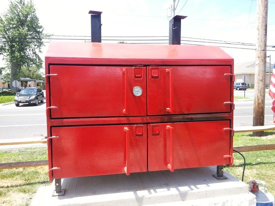 The BBQ LLC: Huge red grill/smoker that faces Rt 9.