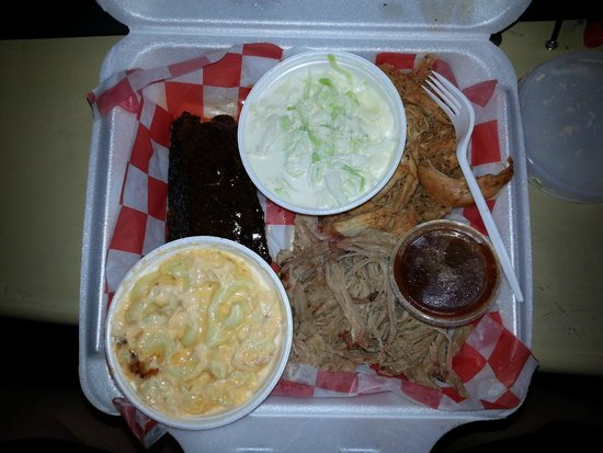 The BBQ LLC: BBQ Sampler, ribs, pulled pork and chicken. Sides of cole slaw and mac n cheese.