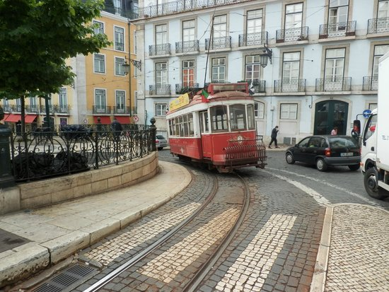 Bairro Alto Hotel: The hotal is just on the left. Historic tram