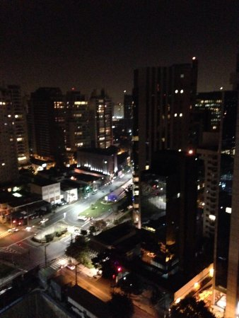 The Capital Managed by AccorHotels : Night time view from rooftop pool