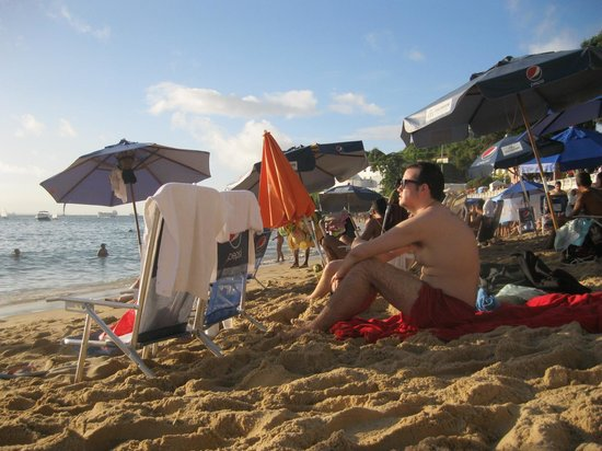 Praia do Porto da Barra : People lined up deep on a beautiful hot day