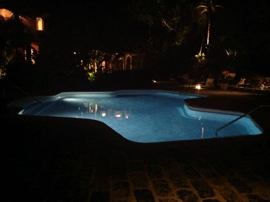 Emerald Beach: The pool lit up at night