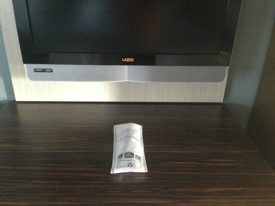 BEST WESTERN University Inn Santa Clara: T.V. Remote was wrapped in cloth to protect from germs.