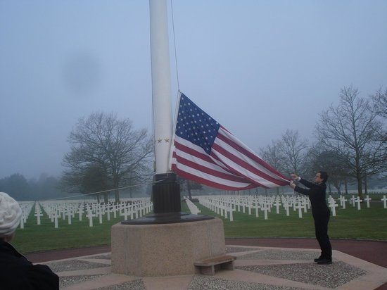 Battle of Normandy Tours : Raising the Flag at Normandy Cemetery
