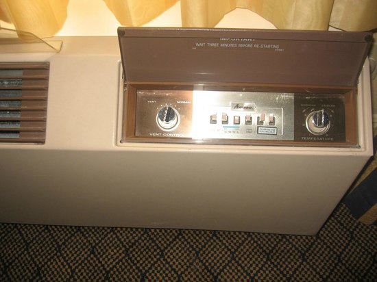 Ayres Hotel & Suites in Costa Mesa - Newport Beach: Old AC/heat/air control unit in one of our rooms--harder to use
