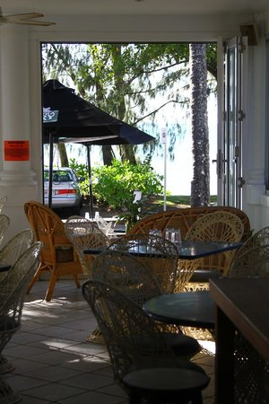 The Rising Sun Bar & Bistro: Looking from inside past outdoor seating to beach