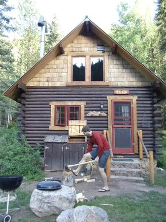 Pioneer Guest Cabins: Chopping wood