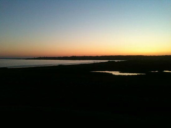 Cape View Motel and Cottages : Sunset over Mavillette Beach from the back of our room.