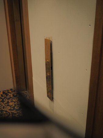 Salisbury Hotel: Elevator button panel pulling away from the wall