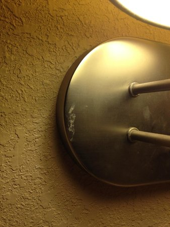 La Quinta Inn & Suites Fairfield : Mysterious dried up white stain on lamp fixture beside bed (Don't ask)