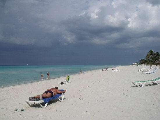 Club Tropical: Storm rolling past parallel to the beach