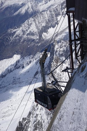 Cable car entering the Aiguille du Midi bay