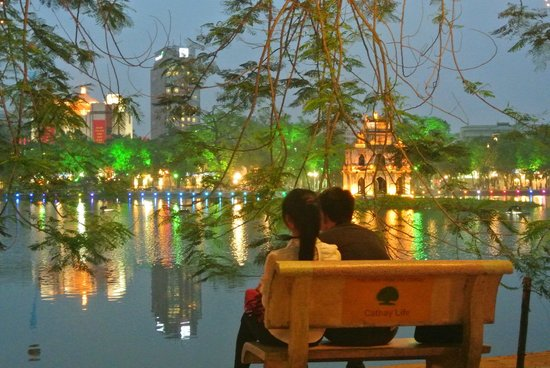 Lake of the Restored Sword (Hoan Kiem Lake): Beautiful lights prompting couples to sit and watch the scenary
