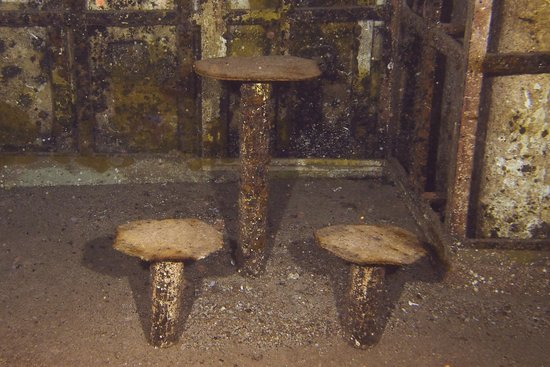 Kittiwake Shipwreck & Artificial Reef: table and chairs in mess hall