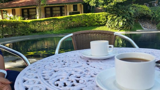 Cardamom County: Tea / Coffee time by the pool