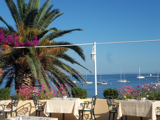 Corfu Palace Hotel: Outdoor dining with a sea view