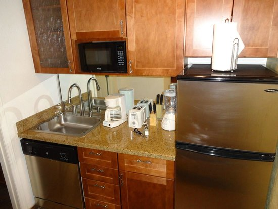 Americana Village: Kitchenette in room - fully stocked