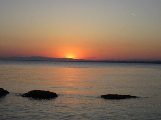 Cuba Bar: Sun setting over the sea.