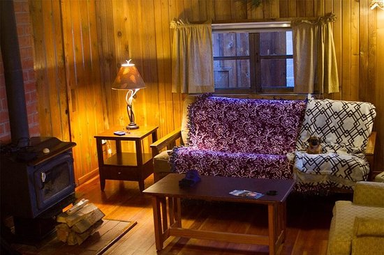 West Beach Resort: Rustic wood and a fireplace make for a homey stay.