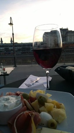 Wine and cheese at sunset in Puerto Madero