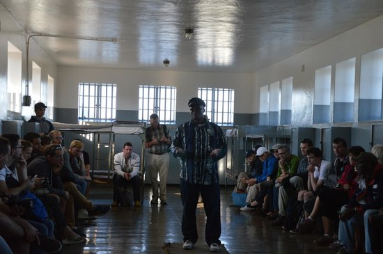 Robben Island: The guide and us locked up in one of the prisons cells...