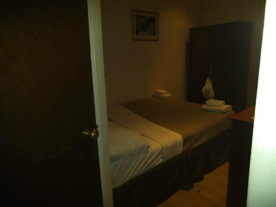 Premier West Hotel: quarto
