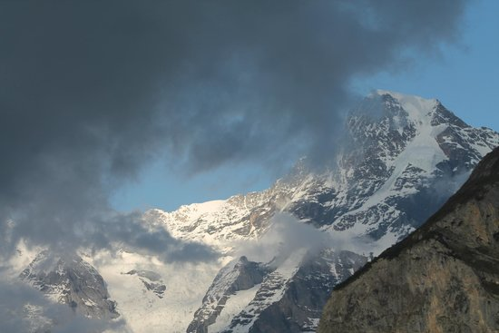 Hotel Alpina: Clouds rolling past Eiger and Monch