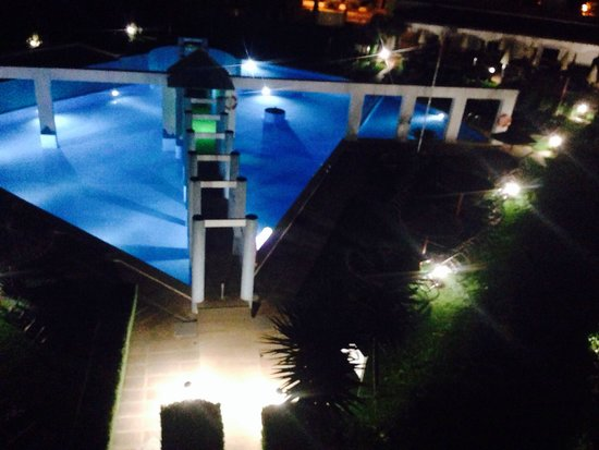 Ona Garden Lago: View of pool at night lit up