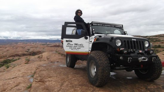 Dan Mick's Guided Jeep Tours: wife posing with the jeep