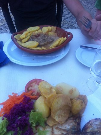 Restaurant O Veleiro : Pepper steak on top plate, fish dish with potato scrounged from pepper steak dinner on my plate!