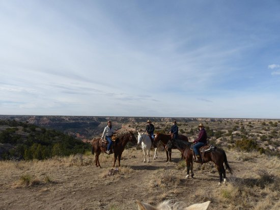 Cowgirls and Cowboys in the West: Riding the range.