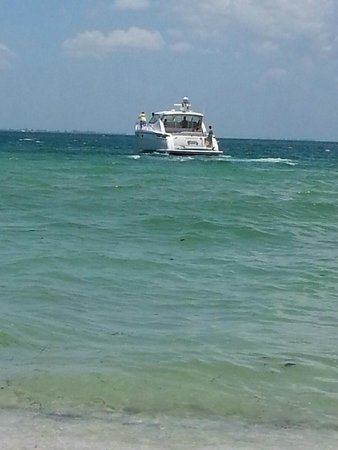 Family sail in for beach fun, then sailed away from Bean Point.