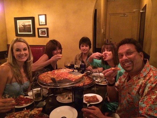Spinato's Pizza: Happy Family Fully Enjoying Spinatos Pizza!