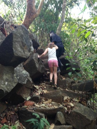 Los Tercios Waterfall: Tourist Police helping my daughter with the scramble
