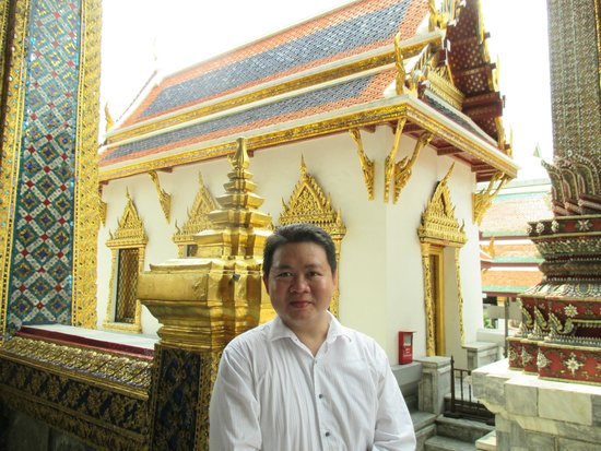 Temple of the Emerald Buddha (Wat Phra Kaew): Husband take photograph outside the main praying room
