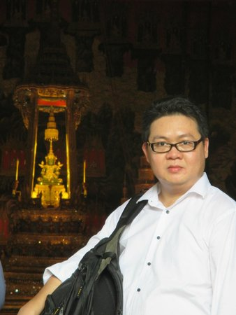 Temple of the Emerald Buddha (Wat Phra Kaew): Husband with Emerald Budha Statue in the background