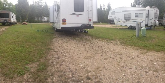 St. Ignace / Mackinac Island KOA: Water to the far left, electricity to the far right. A little bit like playing twister with util
