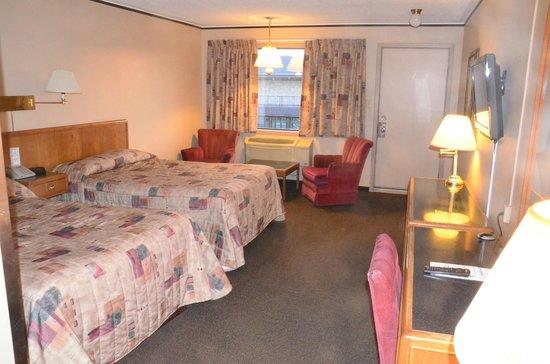 Companion Hotel/Motel: Bedroom (looking toward outside door / window)