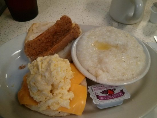Hot sausage, egg and cheese breakfast biscuit with grits