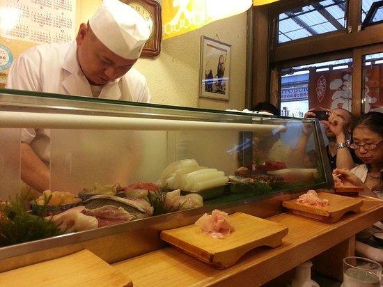 Daiwa Sushi: Chef preparing sushi