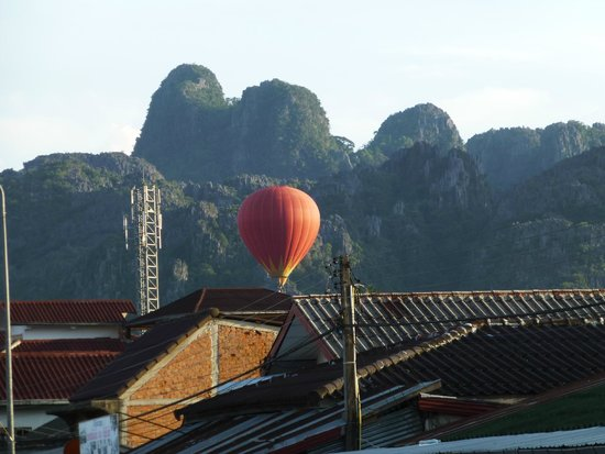 View from bed for Domon river guesthouse vang vieng