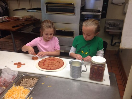 Nik-N-Willie's Pizza & Subs : Helping to make pizza