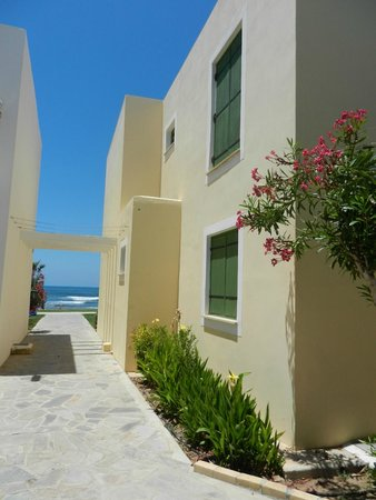 Kefalos Beach Tourist Village: Side of our apartment (shutter on bedroom window)