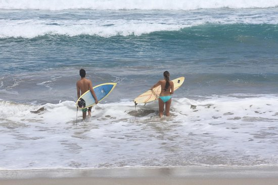 Mariposa Vacation Homes: Brother and sister heading out to surf some beautiful waves