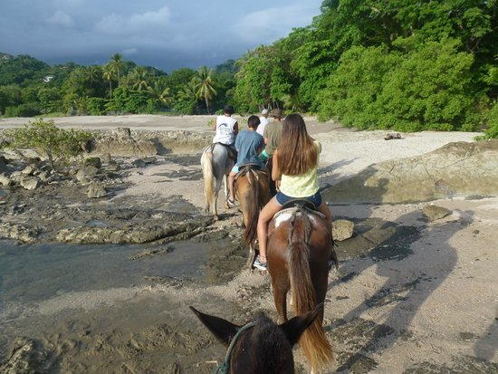 Mariposa Vacation Homes: Horseback riding on the beach and getting caught in a rain storm was actually exciting!